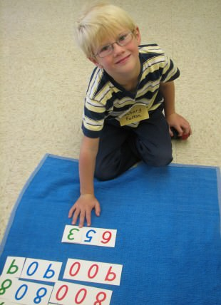 Kindergarten student Zachary Fulton uses one of the classroom activities at Dearborn Heights Montessori Center to learn about the formation of numbers.