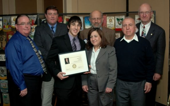 2011 Hugh Archer Memorial Scholarship winner Norman Orabi, center, is pictured with his mother Nourhan Orabi and his father Ahmad Orabi. Pictured in the back row are (L to R) Dearborn Superintendent of Public Schools Brian Whiston, Dearborn High School Principal Chuck Baughman, Archer Scholarship Committee member Tim Richards, and Archer Chairperson Lee Hollmann.