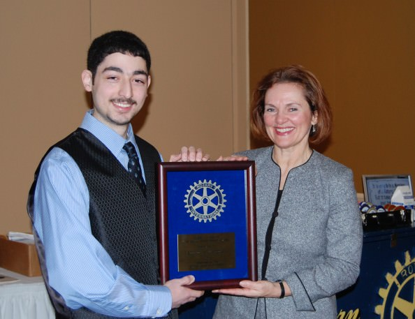 Sisson Scholarship winner Ahmed El-Moussa from Fordson High School. is pictured with Val Murphy-Goodrich, this year's Sisson Award Committee Chairperson.