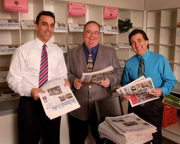 Raad Alawan, publisher of School Life, from left, distributes the newspaper to the Dearborn Public School district's support services building with Superintendent Brian Whiston and Communications Coordinator David Mustonen. Copyright2011Doriguzzi