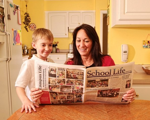 Howard Elementary student Mark Konchal and his mother, Julie Konchal, look over articles in School Life. Copyright2011Doriguzzi