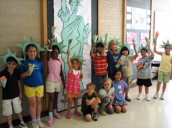 Summer campers at Dearborn Heights Montessori Center learn about the Statue of Liberty and other historical figures during the summer camp program.
