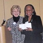 Pro-Literacy Detroit CEO Margaret Williamson accepts donation...