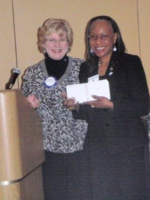 Pro-Literacy Detroit CEO Margaret Williamson accepts donation...