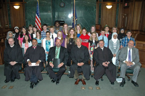 Michigan Supreme Court Chief Justice Robert P. Young, Jr. joined the judges of Dearborn's 19th District Court on May 10 to celebrate the 54th anniversary of Law Day. Seen here congratulating the 24 fifth- through eighth-grade winners of the 2011 Law Day essay contest are (front row, from left): 19th District Court Chief Judge Mark Somers, Justice Young, Dearborn Mayor John B. O'Reilly, Jr., Judge William Hultgren, Judge Richard Wygonik and Dr. John Artis of the Rotary Club.
