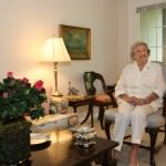 Betty Swanson, former resident of Grosse Pointe Farms, welcomes visitors to her apartment at Oakwood Common in Dearborn.