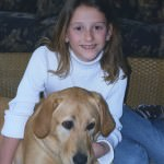 Mary Kate Abraham & Dublin, the family's Labrador Retriever who was killed in the family's house fire in September 2009.