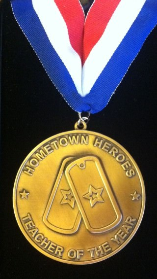 This is the Hometown Heroes Award presented by HISTORY Channel and Vietnam Veterans Memorial Fund to Dearborn teacher Lisa Lark.
