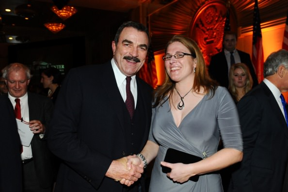 Tom Selleck, Vietnam Veterans Memorial Fund national spokesperson, congratulates Lisa Lark on receiving the Hometown Heroes Award on November 11 in Washington, D.C. at the Build the Center Benefit.