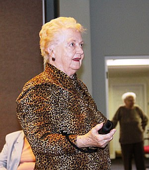 Oakwood Common resident Catherine Kitty Cox smiles after she throws a strike in the Wii bowling tournament.