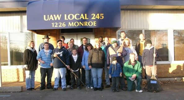 MaryAnn Manduch and Marsha Koet from the City of Dearborn Senior Services Division and members of the UAW Local 245 members pose before they begin the 10th Annual Rake the Leaves event to help homebound seniors with yard work.