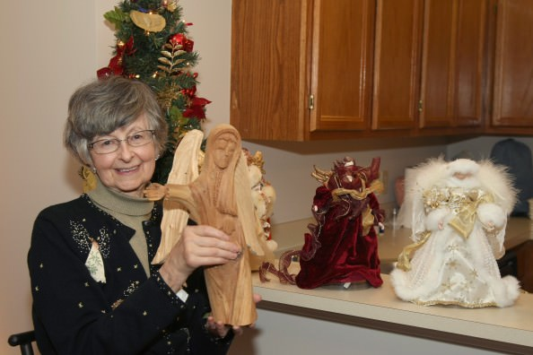 Mary Ann Zawada displays part of her angel collection that came with her in the recent move to Oakwood Common.
