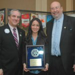 Dearborn High School senior Amanda Amen displays the Harry A. Sisson Memorial Scholarship Award she received. The award as presented by Rotarian of the Year Jim Ives, at left, and John Artis, Dearborn Rotary Club president.