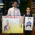 From left to right- Edsel Ford Junior Hamzeh Abdorabehe, and Kaidhum Ganem, Geer Park Elementary Fourth Grader, show off their winning designs.