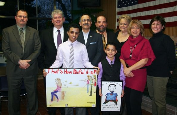 L to R: Dan Blessing (Assistant Principal, Edsel Ford High School), Gary Woronchak (Wayne County Commission Chairman), Hamzeh Abdorabe (Junior, Edsel Ford High School), George T. Darany (State Representative), Jack O'Reilly (Mayor of Dearborn), Kaidhum Ganem (Geer Park Elementary, 4th grader), Jacqui Rivait (Student Services Program Specialist), Andrea Awada (Principal Geer Park Elementary), Beth Brown (Art Teacher, Geer Park Elementary)