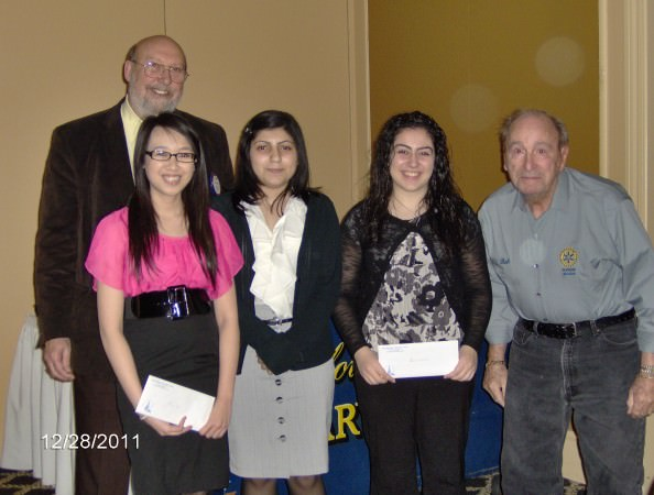 Accepting the Robert M. Young and Past Presidents Scholarship are, from left, Kim Le, Edsel Ford High School; Hana Chovcair, Dearborn High School, and Mayla Harp, Fordson High School with Rotarian Bob Young, at right, and John Artis, Dearborn Rotary Club president.