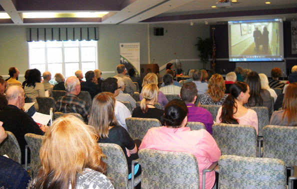 Veterans, spouses, caregivers and social workers listened intently to presenters at Oakwood Common's March workshop about the Veterans Aid & Attendance pension benefit.