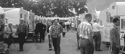 A row of camping trailers at a Tin Can Tourist rally.