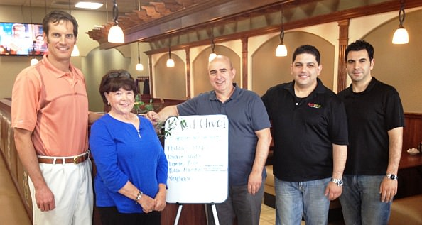 Meeting together at Red Olive in Dearborn's Westborn Mall are, from left, Tom Petzold of Petzold Enterprises, the shopping center's owner, and Anna Ford, hot dog cart owner, with Red Olive founder Pete Goulas, partner Joe Sayah and store manager Jad Sayah.