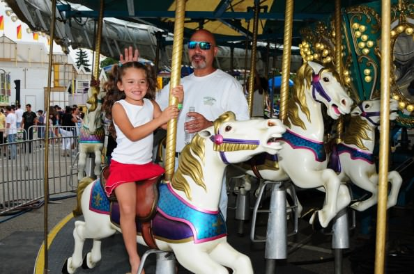 Carnival-goers enjoy rides at Dearborn's Homecoming festival, which this year is Aug. 3-5 at Ford Field Park. Discount all-day wrist bands are available for $13 through 11:59 p.m. Aug. 2 at www.cityofdearborn.org.