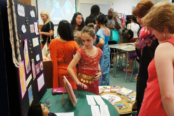Fourth grader Lydia Mills presents her research about ancient India culture to classroom visitors.