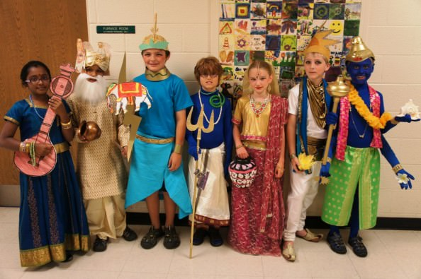 Third grade students dressing as India gods and goddesses are, from left to right, Diksha Iyer, Devan Dhruna, Gordon Washington, Ben Johns, Maggie Watts, Emilio Cascardo and William Stephens.