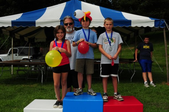 "Plenty of wacky games, like the spaghetti slurp and the hula hoop contest, are free at Dearborn's Homecoming festival Aug. 3-5. Winners receive medals and get the ""Olympic"" treatment. (Photo by the City of Dearborn)"