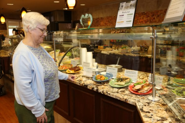 Oakwood Common resident Shirley Balger views menu options in the Bistro café.