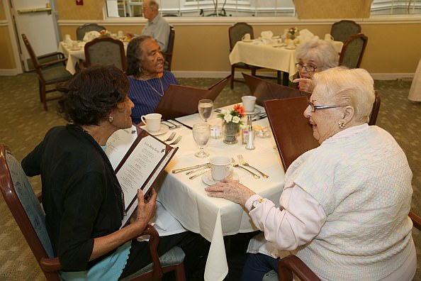 Louise Eason, at left, enjoys before dinner conversation with her guest and former neighbor Mattie Edwards, and Oakwood Common residents Irene Brown and Margaret Schultz.