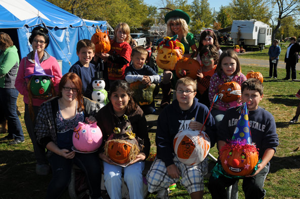 Pumpkin decorating contestants in 2010 show off their creations during Camp Dearborn's Halloween Weekends.