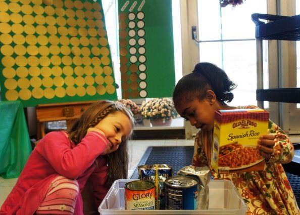 Girls weigh food