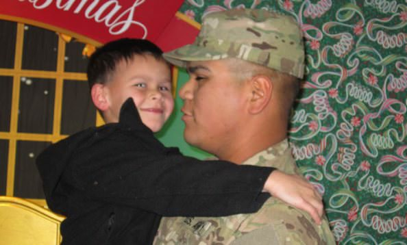 Dominick Garcia, 5, shows his delight and surprise at the Dearborn Rotary Santa Snaps workshop during the Wayne County Lightfest as he is reunited with his dad U.S. Army Specialist Jaime Garcia, following his return from Afghanistan.