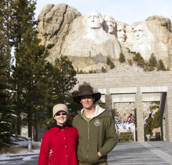 Gaby and Jackson Richards are pictured in front of Mt. Rushmore on their adventure across North America.