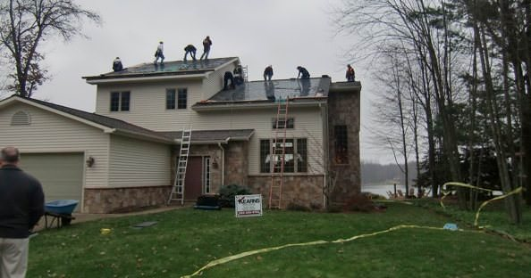 A Kearns Brothers work crew installs DOW POWERHOUSE solar shingles on a Michigan home.