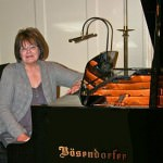 Jean Thayer, musical director for Cherry Hill Presbyterian Church, seated at the Bosendorfer piano.