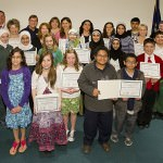 Wayne County Commission Chairman Gary Woronchak (D- Dearborn) is joined by a host of Dearborn students and teachers who were recognized for their involvement with the annual Michigan Green Schools program.