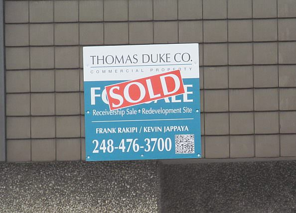 Sold Sign on Old Vic Tanny Building