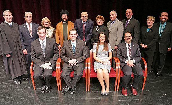 City officials were inaugurated on Jan. 2. Shown here are (front row, from left):   Councilman Brian O'Donnell, Council President Pro Tem Thomas P. Tafelski,   Councilwoman Susan A. Dabaja, and Councilman Michael T. Sareini. (Back   row, from left): Michigan Supreme Court Justice Brian Zahra, Councilman Mark   Shooshanian, Debbie Dingell, Imam Hassan Al-Qazwini, Congressman John   Dingell, Suzanne Sareini, Councilman Robert A. Abraham, Councilman David   Bazzy, the Rev. Fran Hayes and Mayor John B. O'Reilly, Jr.