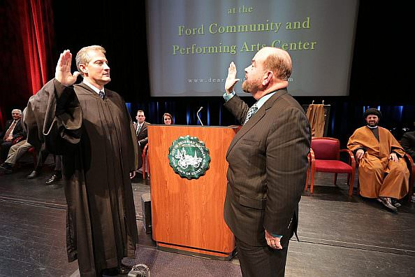 Michigan Supreme Court Justice Brian Zahra administers the oath of office to   Mayor John B. O'Reilly, Jr. during the inauguration ceremony on Jan. 2.