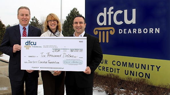 DFCU Financial President and CEO Mark Shobe, DFCU Financial Oakwood/Southfield VP and Branch Manager Caryn Solferino and Dearborn Education Foundation Executive Director Eddie Fakhoury