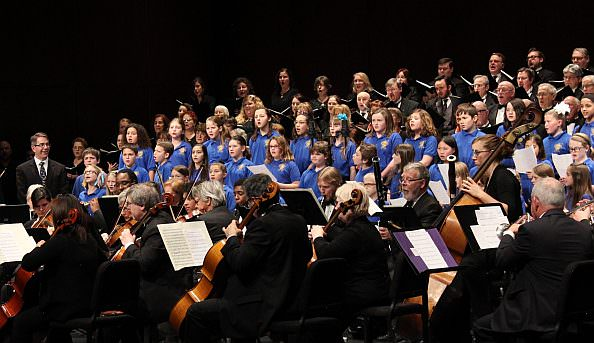 More than 200 performers filled the stage with instrumental music, song and dance on February  1 during the collage concert at the first-ever Saturday Night Alive event which generated  $10,000 in funds for the Michael A. Guido Theater Restoration Fund. On stage in the photo: the  Dearborn Symphony, Vanguard Voices, Dearborn Community Chorus, Motor City Brass Band  and the Dearborn Public Schools Honors Choir. The Dearborn Players Guild and the Dearborn  Community Chorus also performed at the event.