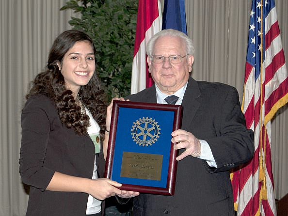 Rasha Khanafer, Dearborn High School senior and 2014 recipient of the Harry A. Sisson Memorial Scholarship, receives the award presented by Dearborn Rotarian Bob Ziolkowski.