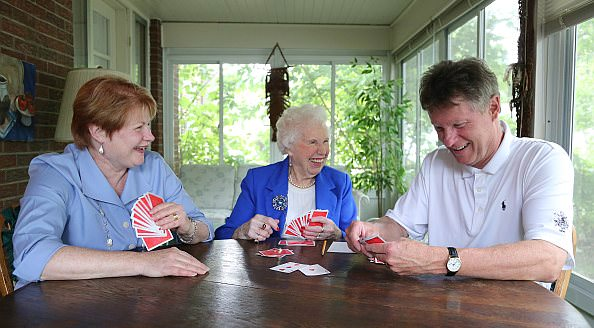 Colleen Stieper, an avid card player, enjoys a game with daughter Kristine Levesque and son Nelson Stieper.