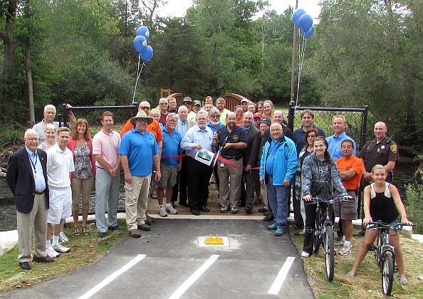 Mayor John B. O'Reilly, Jr. (center,with scissors) was joined by Recreation and Parks Commissioners, city staff, Councilman Robert Abraham and others at the Aug.27 opening  for the Non-Motorized Trail at Camp Dearborn.