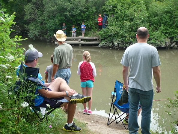 Rotary volunteers, children and family members try their luck at the Dearborn Homecoming Fishing Derby.