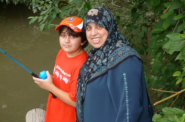 Dearborn resident Sanae Abbas with her son Mehdi at the Fishing Derby