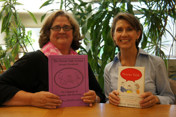 Parent Talk facilitators Heidi Gauger, at left, and Sue Fitzpatrick of Dearborn Heights Montessori Center display materials that will be used during the school's parenting workshop series this fall.