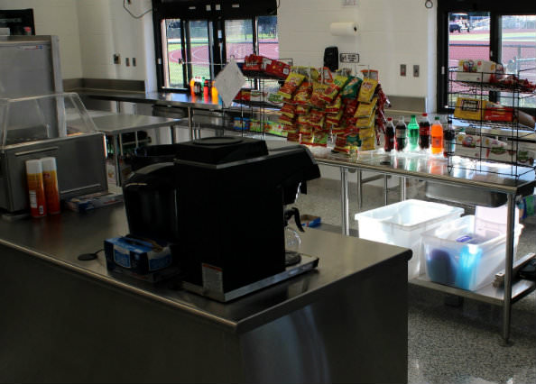 A kitchen, complete with stove, microwave and other amenities will make it easy for those  working the concession stand to serve the fans.