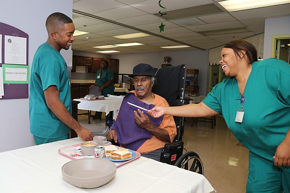 Lunchroom staff at Oakwood Rehabilitation and Skilled Nursing serve and chat with resident Jimmy Cox.
