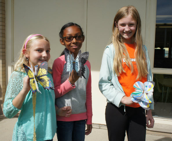 Colorful butterfly peace symbols - made by DHMC students Sarah Horan, from left, Sydnie Kelly and Maya Liljegren.